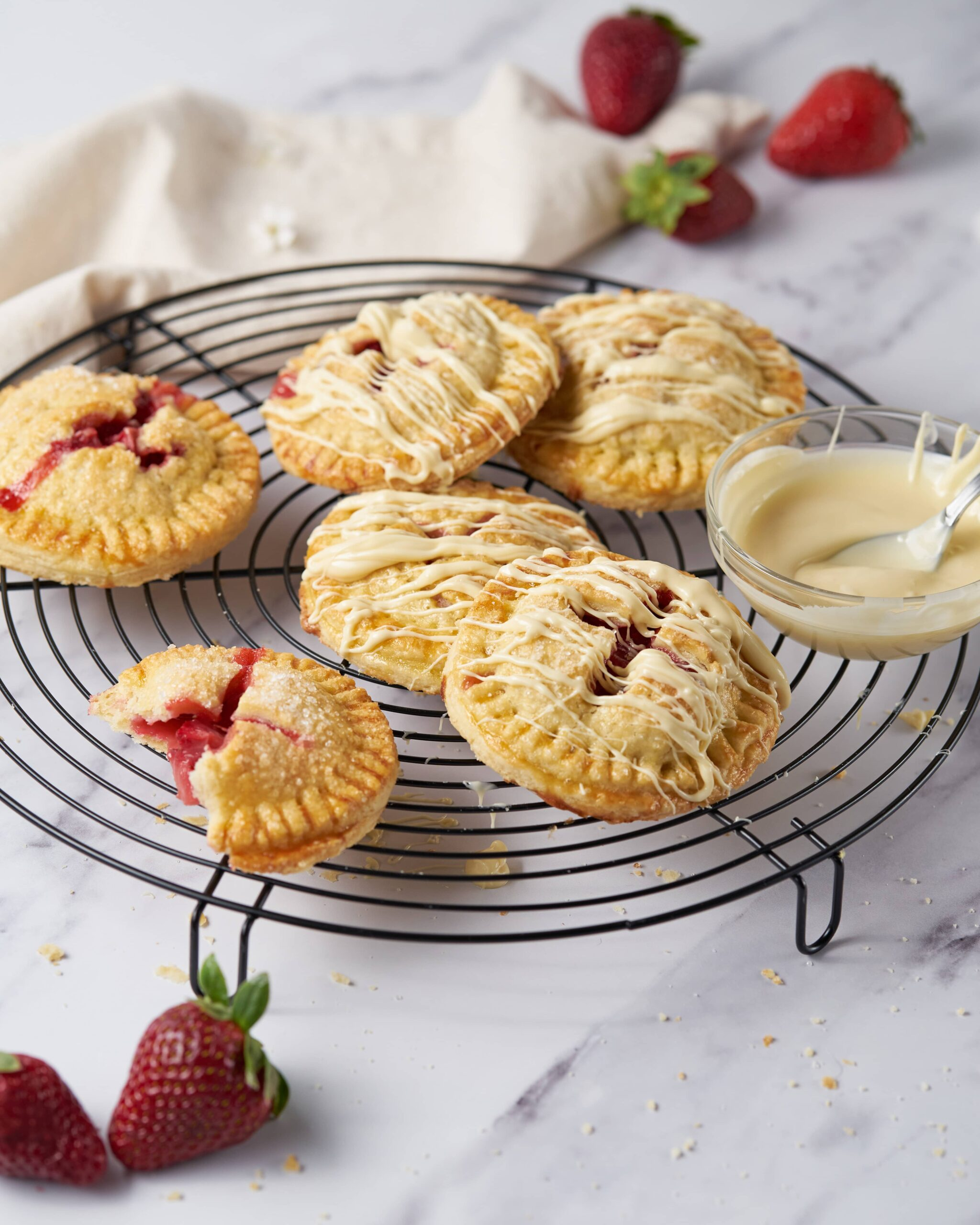 Strawberry Hand Pies with White Chocolate Drizzle